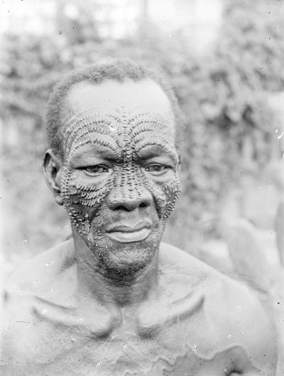 Mbuya-man with typical facial scarifications